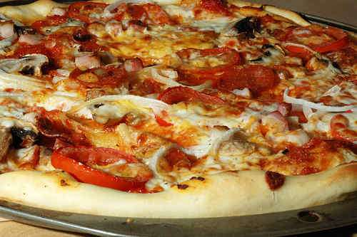 Photo of Pizza with Bacon, Pepperoni and Garlic